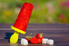 Strawberry homemade Popsicles with sugar and berries outdore Royalty Free Stock Images