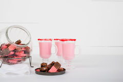 Strawberry Hot Chocolate and Chocolate Dip Cookies. Strawberry hot chocolate drink served with chocolate dipped cookies Royalty Free Stock Photos