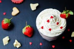 Strawberry hot white chocolate with whipped cream and strawberri Stock Photo