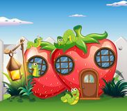 Strawberry house with caterpillars in garden. Illustration Royalty Free Stock Photos