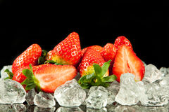 Strawberry on the ice on black background berry fruits Royalty Free Stock Image