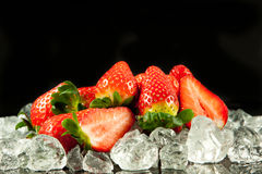 Strawberry on the ice on black background food postcard Stock Images