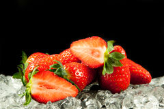 Strawberry on the ice on black background food postcard Royalty Free Stock Photo