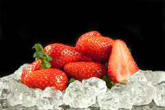Strawberry on the ice on black background food postcard Stock Photo