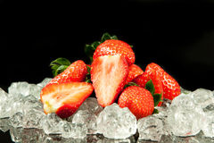 Strawberry on the ice on black background food postcard Stock Photos