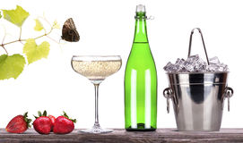 Strawberry, ice bucket  with champagne  on a table Stock Photos