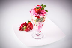 Strawberry ice cream. With berries, mint and kiwi slices Royalty Free Stock Photo