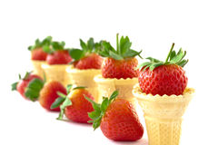 Strawberry ice cream concept. Strawberries and  wafer cones in a row Stock Photo