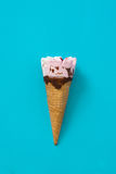 Strawberry ice cream cone on blue background. Fresh Strawberry ice cream cone on blue background Royalty Free Stock Photography