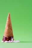 Strawberry ice cream cone on green background. Summer Strawberry ice cream cone on green background Royalty Free Stock Images
