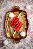 Strawberry ice cream. Displayed on a vintage tray royalty free stock image