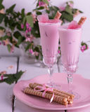 Strawberry ice cream with ice in the shape of a heart in glasses Stock Photography