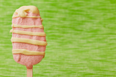 Strawberry ice cream popsicle with chocolate Stock Photo