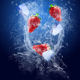 Strawberry and ice under water Royalty Free Stock Photography