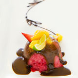 Strawberry icecream with chocolate sauce. Strawberry icecream with fruit and chocolate sauce Royalty Free Stock Image