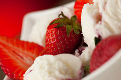 Strawberry icecream in a white bowl  with strawberries Royalty Free Stock Photography