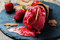 Strawberry icecream. On the wooden table, selective focus Stock Image