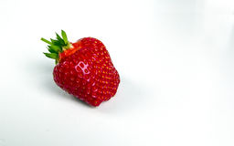 Strawberry isolated on white background. Perfectly retouched strawberry  and leaves isolated on white background with clipping path. One of the best isolated Stock Images