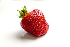 Strawberry isolated on white background. Perfectly retouched strawberry  and leaves isolated on white background with clipping path. One of the best isolated Stock Photo
