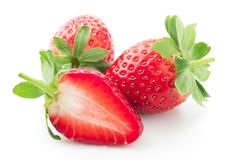 Strawberry isolated on white. Whole and cut strawberries isolated on white background Royalty Free Stock Images