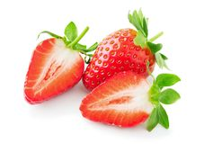 Strawberry isolated on white. Whole and cut strawberries isolated on white background Stock Images