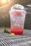 Strawberry italian soda with ice on wickerwork table Stock Photo