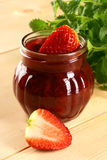 Strawberry jam. Red strawberries jam and glass jar Stock Photography