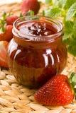 Strawberry jam. Red strawberries jam and glass jar Stock Photo