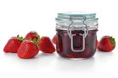Strawberry jam and berries isolated on white. Royalty Free Stock Photo