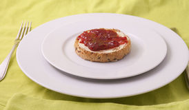 Strawberry jam on a biscuit Royalty Free Stock Photography