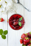 Strawberry jam in a bowl and berry Royalty Free Stock Photography