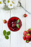 Strawberry jam in a bowl on a white table, top view Royalty Free Stock Image