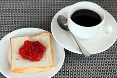 Strawberry jam on bread and coffee Royalty Free Stock Photos