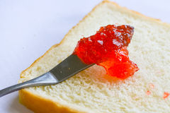 Strawberry jam and bread. Strawberry jam and fresh bread Stock Photos