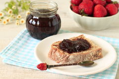 Strawberry jam and bread Stock Images