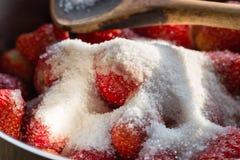 Strawberry jam cooking encore of sugar Stock Photos