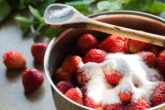 Strawberry jam cooking encore of sugar Stock Photo