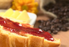 Strawberry Jam on Croissant Stock Photography