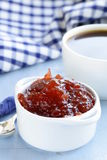 Strawberry jam with a cup of coffee Stock Image