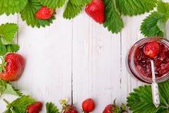 Strawberry jam. Frame. Strawberry jam with fresh strawberries.Frame Royalty Free Stock Image