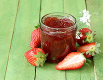 Strawberry jam with fresh berries in a jar Royalty Free Stock Photo