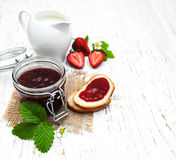 Strawberry jam and fresh strawberries Stock Photo