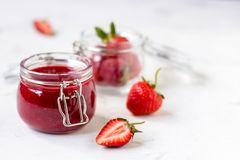 Strawberry jam in a glass jar on the table Royalty Free Stock Photos