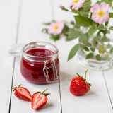 Strawberry jam in a glass jar on the table Stock Photography