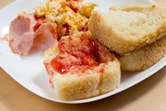 Strawberry jam on homemade bread. At breakfast Stock Image