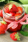 Strawberry jam in a jar and fresh berries Stock Photos