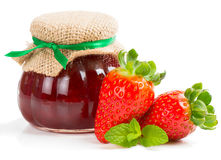 Strawberry Jam. In a jar and fresh berry  on white Royalty Free Stock Images