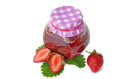 Strawberry jam in jar -  homemade. Jar with strawberry jam and strawberries isolated on white Royalty Free Stock Images