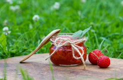 Strawberry jam in a jar Royalty Free Stock Images