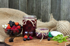 Strawberry jam in a jar on wooden background Stock Photos